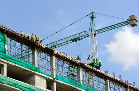 construction site helmet: Group of the workers are working on high constructionsite