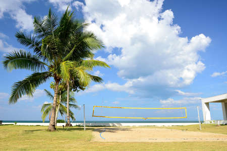 The beach volleyball field have blue sky to be background. photo