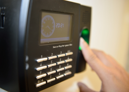 fingerprints: The worker use  fingerprint touch security and time checking machine.