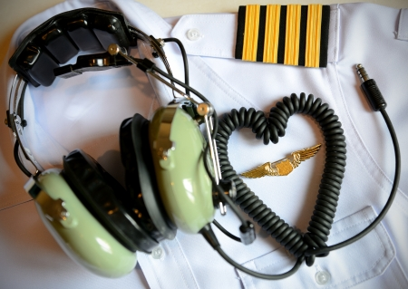 Pilot uniform and  headset for i love to fly concept Stock Photo