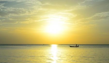 Fisherman are taking fishing boat to fish with sunrise background  photo