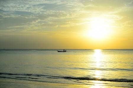 Fisherman are taking fishing boat to fish with sunrise background. photo