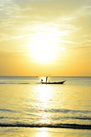 Fisherman are taking fishing boat to fish with sunrise background  photo