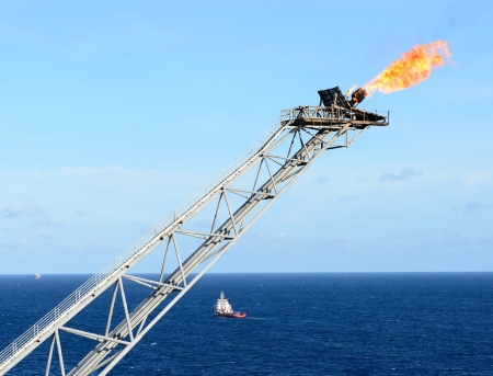 exhaust gases: The gas flare is on the oil rig platform
