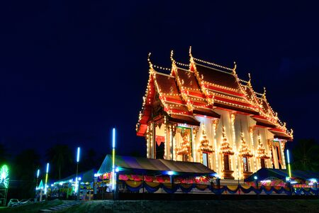 kirk: The exterior thai church is decorated with light at night