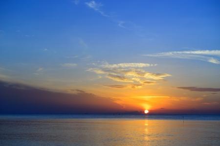 Beautiful tropical sunrise in the sea at Thailand photo