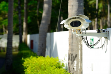security camera on the fence next to the walkway Stock Photo - 15925307