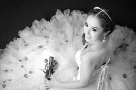 black and white portrait of beautiful bride is smiling photo