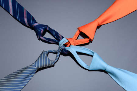 neck tie: neck tie are tied to gether for teamwork concept Stock Photo