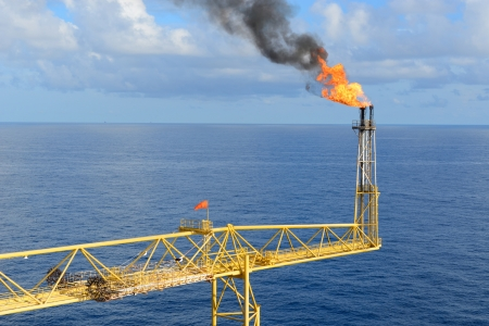 The gas flare is on the offshore oil rig platform. photo