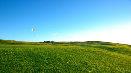 golf course: The flag is on the nice green golf course . Stock Photo