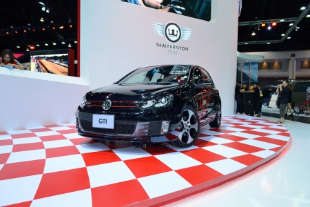 gti: BANGKOK - MARCH 31 : The Volkswagen Golf GTI car with unidentified people on display at The 34th Bangkok International Motor Show 2013 on March 31, 2013 in Bangkok, Thailand.