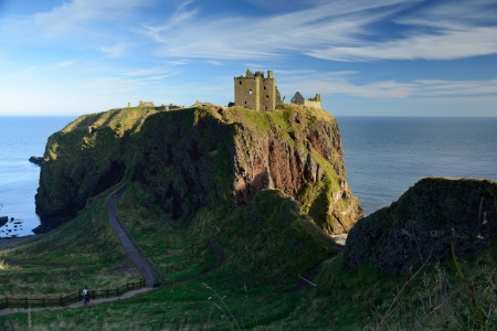 Dunnottar Castle with blue sky background in Abeedeen, Scotland.