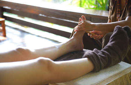 The women massage her foot for thai spa foot massage Stock Photo