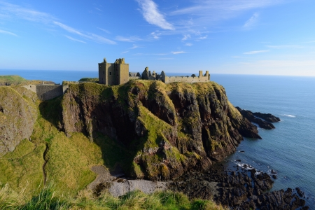 Dunnottar Castle  with blue sky background in Aberdeen, Scotland. Editorial