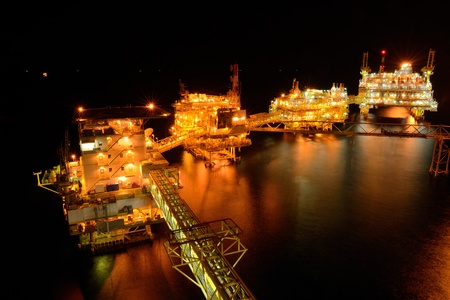 The large offshore oil rig at night in gulf of thailand