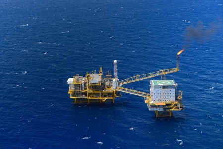 helideck: the top view offshore oil rig platform take from aircraft Stock Photo