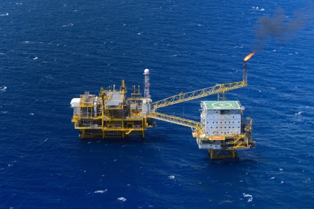 the top view offshore oil rig platform take from aircraft Stock Photo