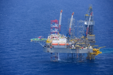 Top view of helicopter pick up passenger on the offshore oil rig