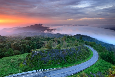 roadway: Sunrise behind mountain at Doi Intanon National Park VIew point, Chiang Mai Thailand Stock Photo