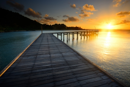 The beautiful wooden pier with sunrise at national park Khao Leam Ya - Mu Ko Samet Rayong, Thailand