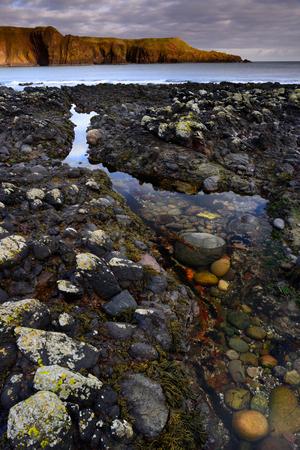 dunnottar castle: beautiful seascape of creek and rock at Dunnottar castle Aberdeen Scotland Stock Photo