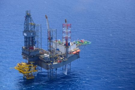 oil park: Top view of helicopter pick up passenger on the offshore oil rig
