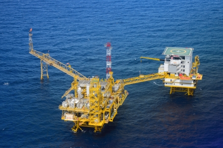 helideck: Top view offshore oil rig platform take from helicopter Stock Photo