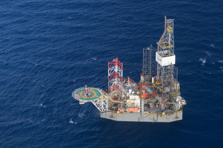 drilling rig: Top view of helicopter pick up passenger on the offshore oil rig.