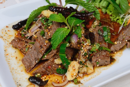 Thai food name is Grilled beef with spicy salad