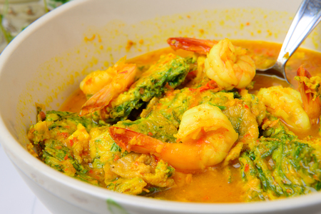 pennata: Thai spicy food name Shrimp and Fried Egg Sour Soup Stock Photo