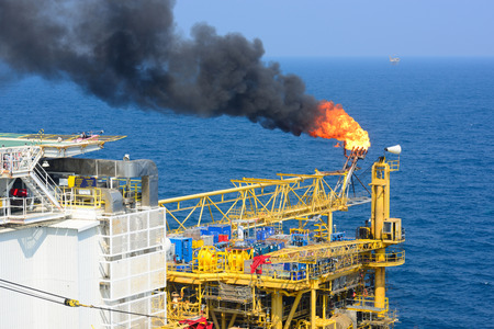 The gas flare is on the offshore oil rig platform Editorial