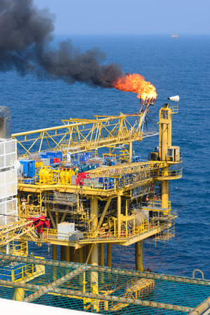The gas flare is on the offshore oil rig platform Stock Photo