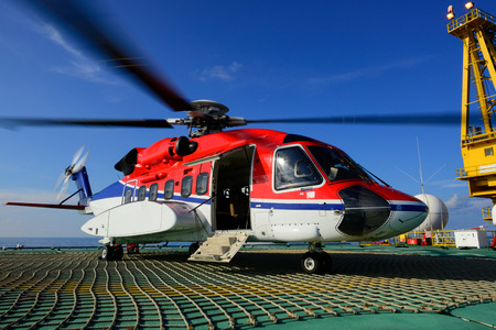 The offshore helicopter park on oil rig to pick up worker Stock Photo
