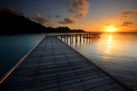 The landscape of beautiful wooden bridge with sunrise in the morning Standard-Bild