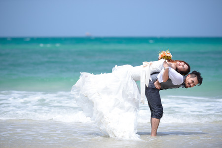 happiness and romantic scene of love couples partners on the  beach Standard-Bild