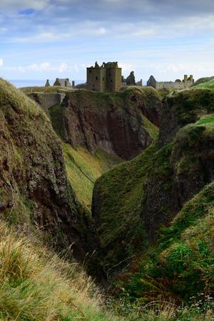 dunnottar castle: Dunnottar Castle with blue sky background in Aberdeen, Scotland