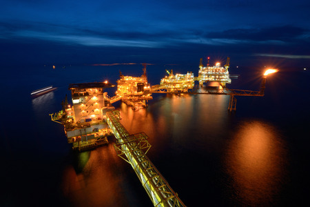The large offshore oil rig platform at night in the gulf of thailand