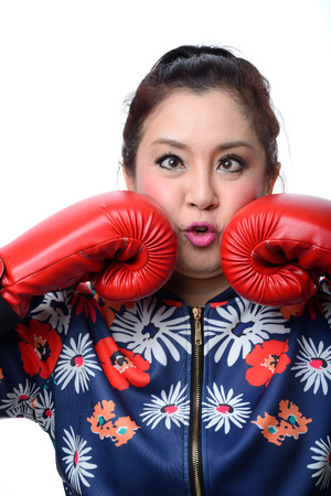 squint: squint eyed crazy woman in boxing gloves isolated on white