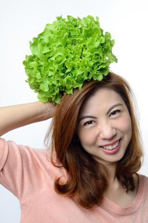 hydroponic: asian woman hold hydroponics green oak vegetable on her head