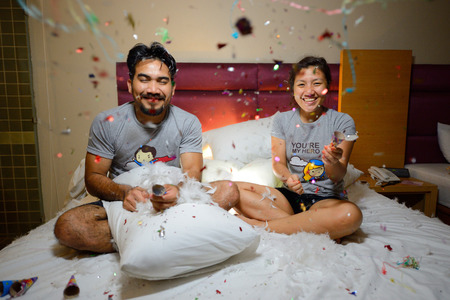 asian couple celebrating new year with fire cracker on bed Standard-Bild