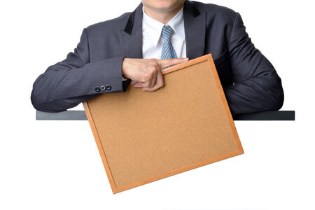 businessman in suit holding blank note board isolated on white background photo