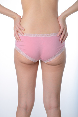 woman panties: asian woman show her fat and cellulite on buttocks on white background Stock Photo