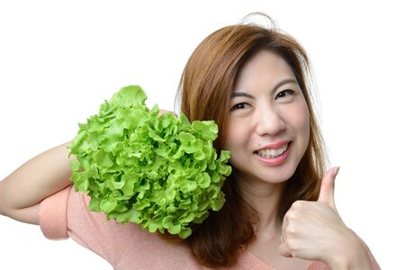 smile asian woman give thumb to hydroponics green oak vegetable isolated on white background,Healthy concept