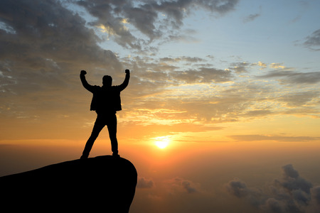 silhouette achievements successful arm up man is on top of hill celebrating success with sunrise