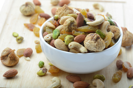 close up mixed nuts in white bowl Standard-Bild