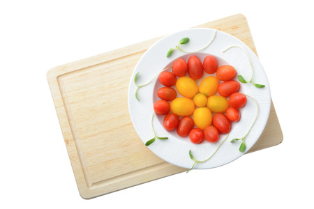 fresh cherry plum tomato on white plate isolated on white background,Healthy eating concept