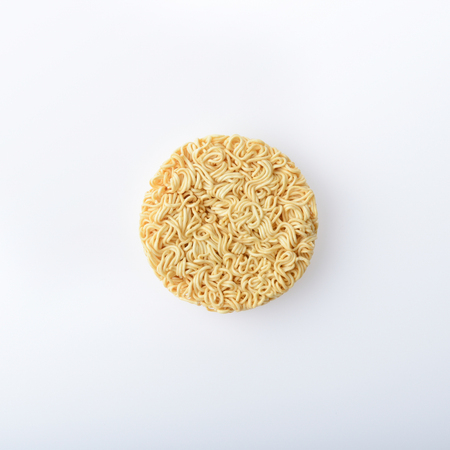 top view of instant noodles on white background