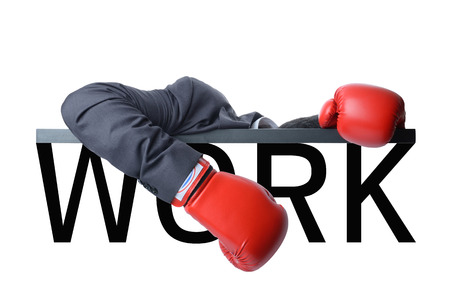 tired businessman with red boxing glove after fight with hard work Standard-Bild