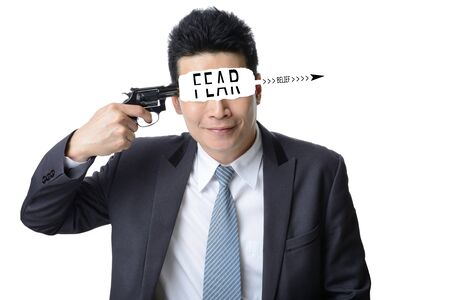 businessman use gun shoot word FEAR in his head isolated on white background ,Motivation concept